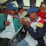 --Caption: BY JAMES H. WALLACE, THE COURIER-JOURNALCharles Johnson, 8, left, and Chris Lampkins, 9, compared medals they received for being in the 20th Annual Don Fightmaster Golf Tournament for Exceptional Children at River Road Country Club. (COLOR PHOTO)--Text 04/27/98 Photo by James H. Wallace - Charles Johnson, 8, left, and Chris Lampkins, 9, compared medals they received for participation in the Kentucky Derby Festival Don Fightmaster Golf Tournament for Exceptional Children at River Road Country Club.
