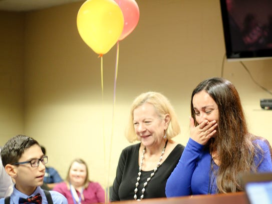 Jessica Maniglia, adoption worker, cries while presenting
