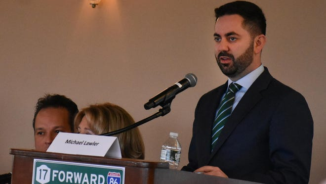 Michael Lawler, director of the 17 Forward 86 coalition, moderates a panel discussion on improving the major highway that runs through Orange and Sullivan counties on Wednesday at the West Hills Country Club in the Town of Wallkill.
