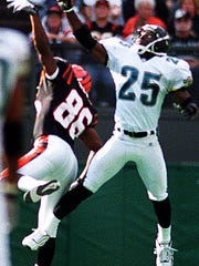 Fernando Bryant (25) breaks up a pass during a 1999 contest. Bryant was the first-round selection of the Jacksonville Jaguars in the 1999 NFL Draft.