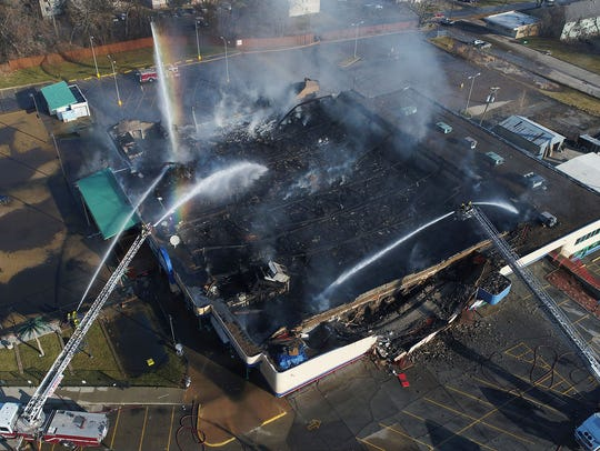 Firefighters battled a large structure fire Monday,