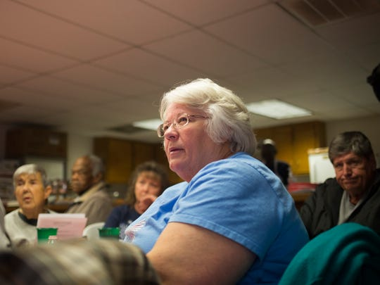 Sherri Kelley of Anderson listens to Sheriff-elect Chad McBride as he outlines some of the changes he'll be making when he starts in January. McBride spoke Monday at the Senior Citizens Luncheon at the Homeland Park Fire Department.