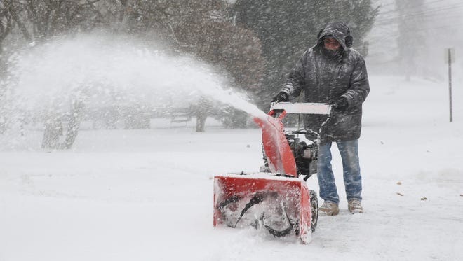 Jim Ferranto clears his driveway with a snowblower in Wappingers Falls on Jan. 4, 2018.