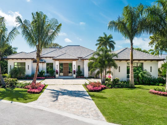 This custom home at 704 Hollybriar Lane in Pelican Bay is ready for immediate occupancy.