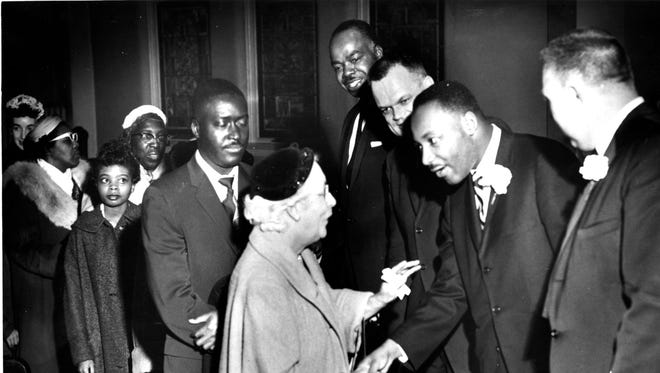 Martin Luther King Jr. stands with Dr David Evans, Reverend Sidney Short and Reverend Paul Bigby to greet attendees and shake their hands after his sermon at First United Methodist Church in 1960.
