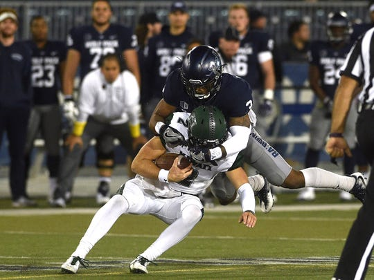 Nevada takes on Hawaii during their football game at