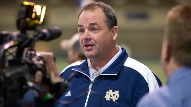 Notre Dame football coach Brian Kelly promoted assistant Mike Denbrock (shown) to offensive coordinator on Thursday.