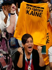 Virginia delegates celebrate the nomination of Tim Kaine for vice president during the 2016 Democratic National Convention in Philadelphia.