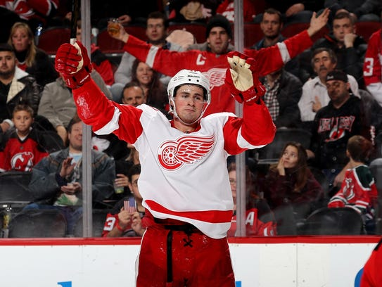 Red Wings forward Dylan Larkin celebrates his goal