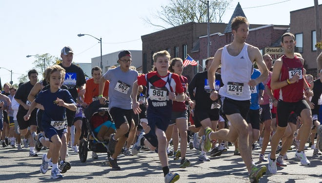 Runners takes off at the start of a 5K held in Denville.