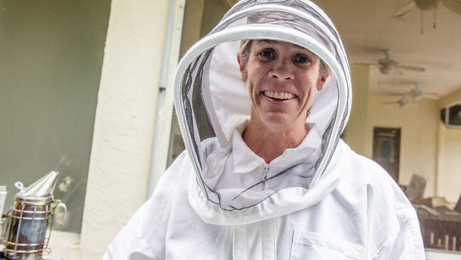 Amy Carden says she became fascinated with bees after seeing some frames of bees displayed outside of Whole Foods by an organization named Backyard Bee Keepers.