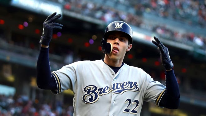 Christian Yelich celebrates after hitting a home run in the fifth inning.