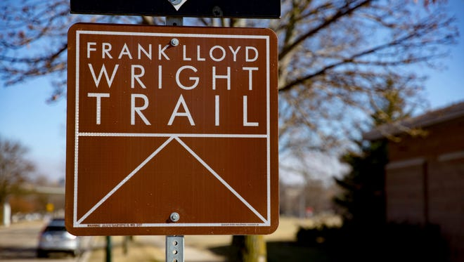 This Feb. 21, 2017 photo shows a sign in Madison, Wis., pointing the way to Monona Terrace, a site on Wisconsin's new Frank Lloyd Wright Trail. The 200-mile route highlights places around the state designed by the famous architect, who was born in Wisconsin 150 years ago on June 8, 1867.