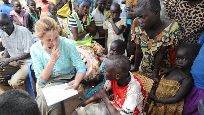 Melinda Henneberger with Moses Amule at the Bidi Bidi Refugee Settlement in Uganda in February 2017.