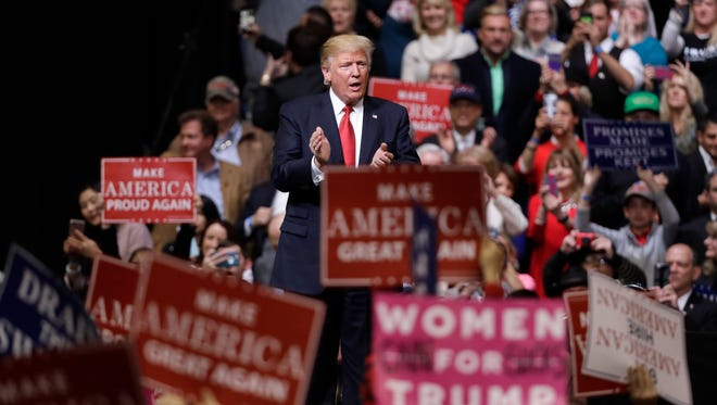 President Donald Trump acknowledges the crowd after speaking at a rally Wednesday, March 15, 2017, in Nashville, Tenn.