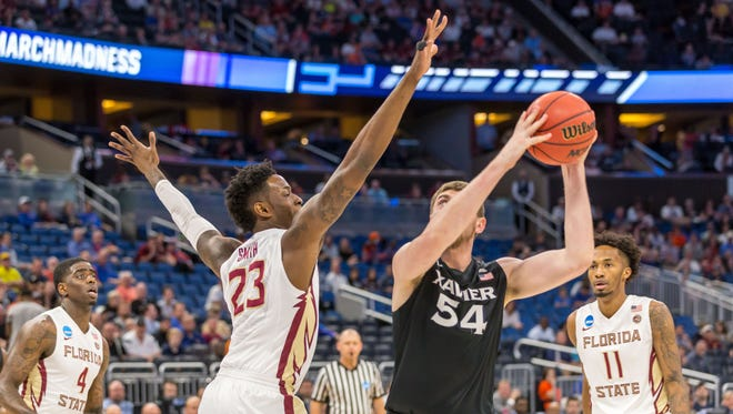 Xavier center Sean O'Mara goes for a shot over Florida State's Jarquez Smith during the Seminoles 91-66 second round loss in the NCAA Tournament on Saturday night at the Amway Center.