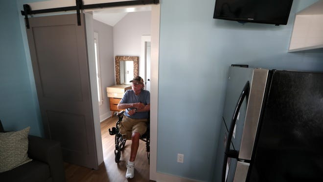 Russell Wallace inspects his new 280 sq-ft tiny home after moving from the Westgate Community Friday, Dec. 1, 2017. Wallace was part of the first phase of 11 residents to relocate to the west Tallahassee community called The Dwellings.