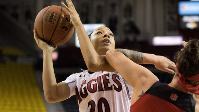 Dominique Mills and the New Mexico State Aggies host UTEP on Sunday at the Pan American Center.
