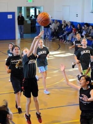 Girls in recreation league play basketball Sunday in Salinas.