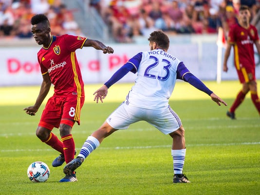 Real Salt Lake midfielder Stephen Sunny Sunday (8) and Orlando City midfielder Antonio Nocerino (23) go for the ball during an MLS soccer match at Rio Tinto Stadium in Sandy, Utah, Friday, June 30, 2017. (Chris Detrick/The Salt Lake Tribune via AP)