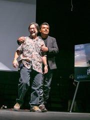 "Actor George Lopez hugs teacher Faridodin ""Fredi"" Lajvardi"