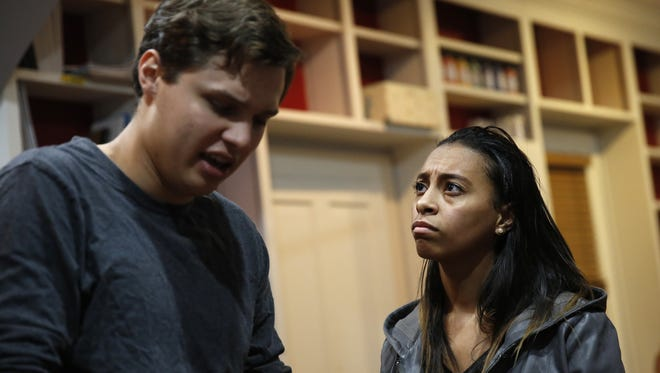 """Alex Fabrega, left, and Kayla Badia rehearse """"A Town Divided"""" at the Oasis Center for Women & Girls Monday, Feb. 12, 2018. The play is a modern take on """"Romeo and Juliet"""" inspired by stories from interracial couples living in Tallahassee."""