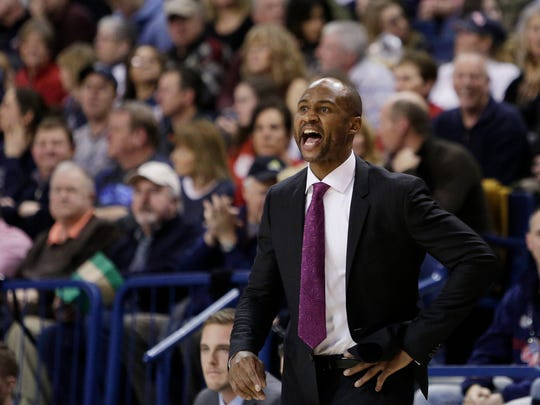 San Diego coach Lamont Smith talks to his team during the first half of an NCAA college basketball game against Gonzaga, Saturday, Jan. 16, 2016, in Spokane, Wash. (AP Photo/Young Kwak)