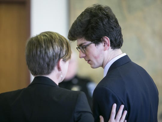 Owen Labrie speaks with his attorney Robin Melone during the first day of a hearing on whether he deserves a new trial, on Tuesday, Feb. 21, 2017 in Concord, N.H. Labrie claims his trial lawyers failed to challenge the felony charge. He was acquitted in 2015 of raping a 15-year-old classmate as part of a game of sexual conquest at St. Paul's School but was convicted of a felony computer charge requiring him to register as a sex offender.