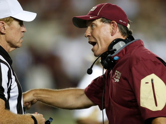Jimbo Fisher gets into it with a referee during FSU's game at Doak Campbell Stadium against Texas State in 2017.