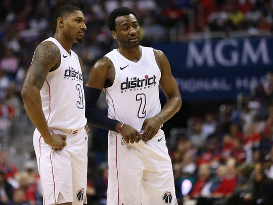 Bradley Beal talks with John Wall during Game 4 against