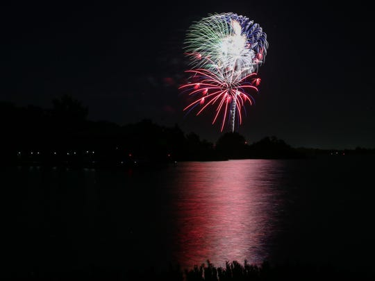 Fireworks burst over the lake during the 10th annual Fourth of July fireworks show Wednesday, July 4, 2018, at Lake Nasworthy.