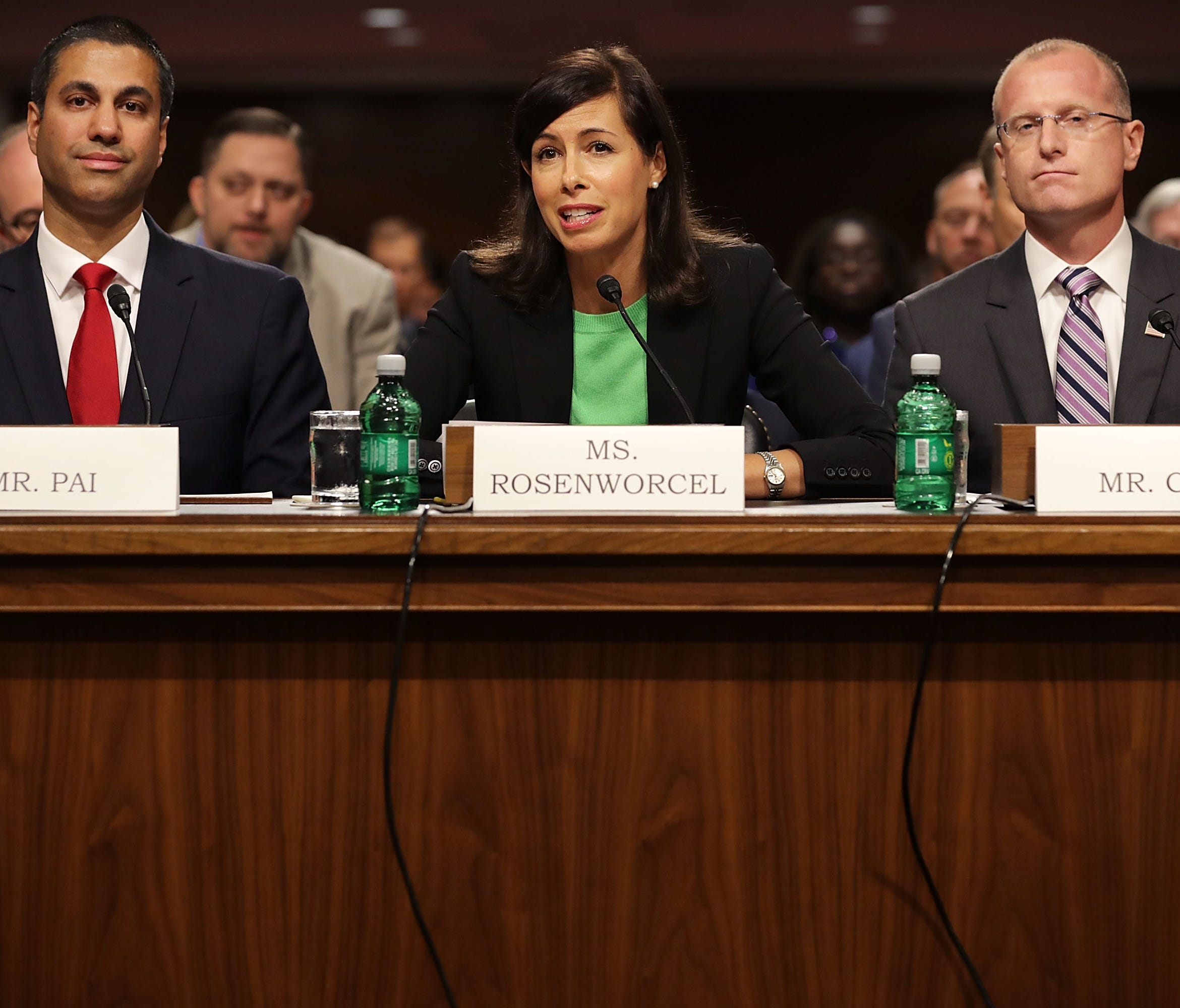 Federal Communications Commission Chairman Ajit Pai and nominees Jessica Rosenworcel and Brendan Carr, left to right, prepare to testify before the Senate Commerce, Science and Transportation Committee during their confirmation hearing July 19, 2017