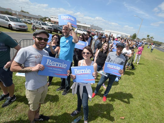 Supporters stand in line to see Bernie Sanders before