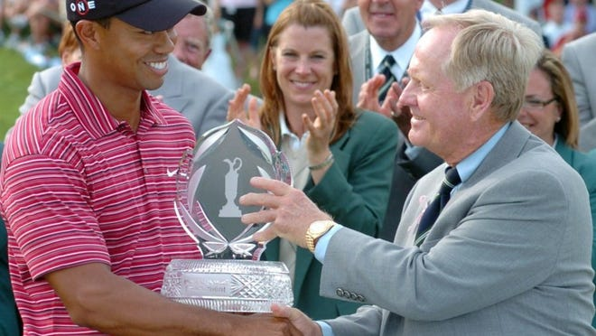 JIM MANDERVILLE/THE NICKLAUS COMPANIES Jack Nicklaus is shown presenting Tiger Woods with the winner's trophy from The Memorial Tournament in 2009.