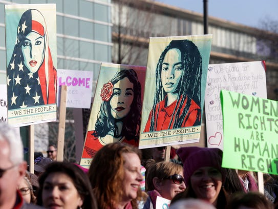 Protesters march for women's rights on the campus of