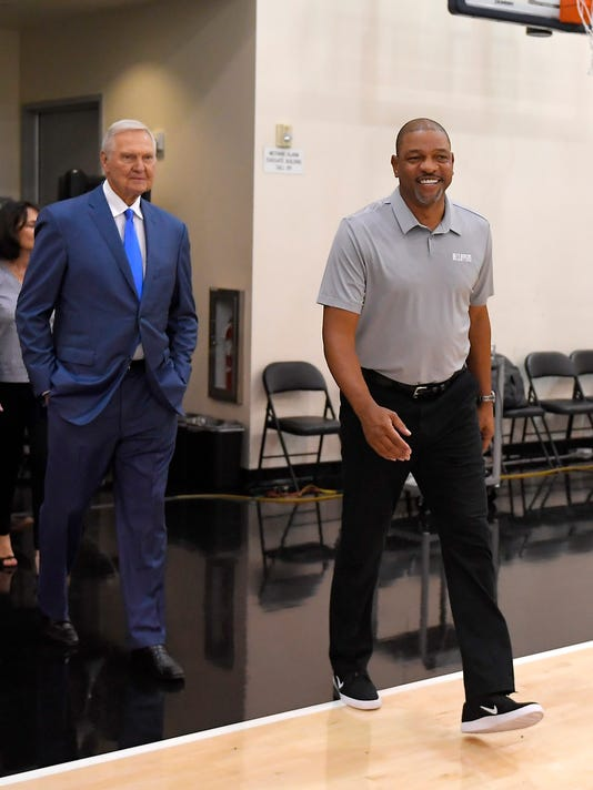 Jerry West, left, walks out for a news conference with Los Angeles Clippers president of basketball operations and head coach Doc Rivers to introduce West as an advisor to the Clippers, Monday, June 19, 2017, in Los Angeles. (AP Photo/Mark J. Terrill)