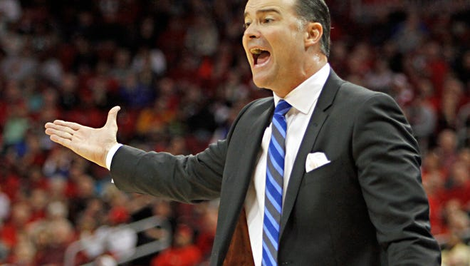 Kentucky coach Matthew Mitchell shouts instructions to his team to a 77-68 upset victory over No. 7 Louisville in their NCAA college basketball game in Louisville, Ky., Sunday, Dec. 7, 2014.  (AP Photo/Garry Jones)