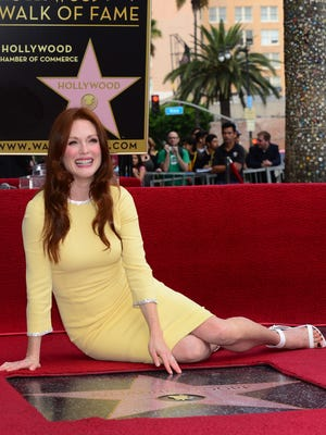 Actress Julianne Moore poses on her just unveiled 'star' on Oct. 3, 2013 in Hollywood, Calif. Moore was the recipient of the 2,507th star in the category of Motion Pictures along the Hollywood Walk of Fame.