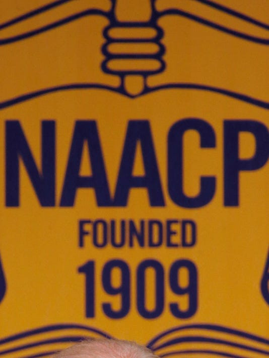 635786844322301268-sign-AP-NAACP-Biden-MIPS102