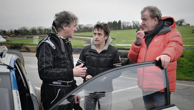 'Top Gear' host Jeremy Clarkson, right, is out, the BBC announced Wednesday. Meanwhile, the contracts of co-hosts James May, left, and Richard Hammond are days away from expiration.