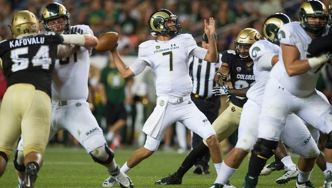 CSU quarterback Nick Stevens throws a pass during last year's Rocky Mountain Showdown game against Colorado in Denver. This year's game between the two rivals will be played at 6 p.m. Sept. 1 in Denver, with the Pac-12 Network providing the television broadcast, CU announced Wednesday.