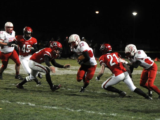 Port Clinton's Nathan Stubblefield, No. 13, carries the ball during the Redskins' playoff game at Kenton on Nov. 7.