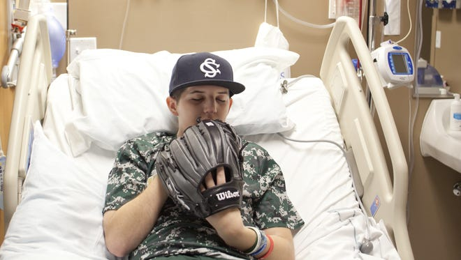 Britton Shipp poses with his baseball glove Tuesday, March 10, 2015.
