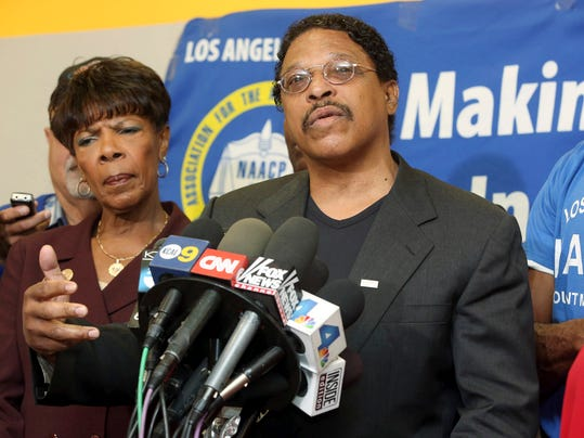Leon Jenkins, right, president of the Los Angeles chapter of the NAACP, announces that Los Angeles Clippers owner Donald Sterling will not be receiving his lifetime achievement award, at a news conference in Culver City, Calif., Monday, April 28, 2014. The Clippers owner allegedly made racially charged comments in a recorded conversation. Sterling had been slated to receive the honor on May 15 as part of the 100th anniversary celebration of the group's Los Angeles chapter. (AP Photo/Nick Ut)