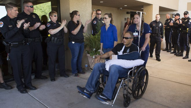 Chandler Officer Joshua Pueblo, who was shot in the face at a Walmart less than a week before, leaves the Chandler Regional Hospital on April 29, 2016, in Chandler.