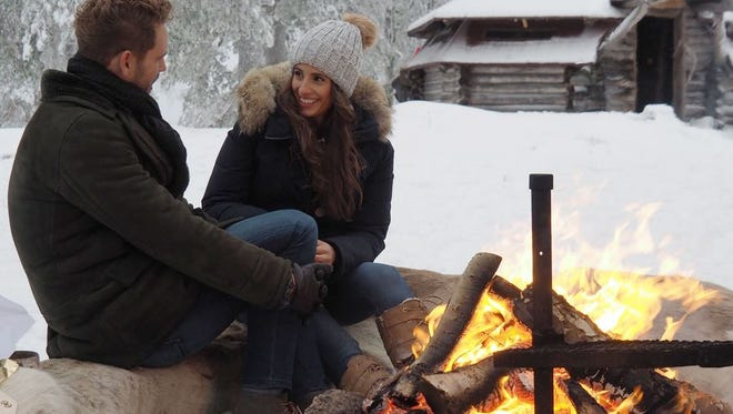 "Vanessa and Nick warm by a fire in Finland during their last date in the season finale of ""The Bachelor."""