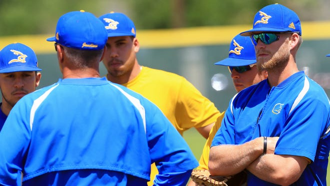 Texas A&M-Kingsville's Jimmy Roche watches on as head coachJason Gonzales talks during practice on Tuesday, March 22, 2017, in Kingsville.