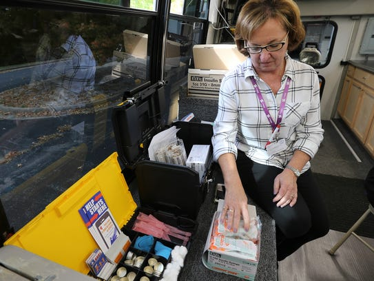 Sally Brunner, RN, prepares items available to intravenous