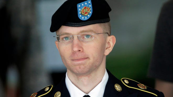 In this  June 5, 2013, file photo Army Pvt. Chelsea Manning, then-Army Pfc. Bradley Manning, is escorted out of a courthouse in Fort Meade, Md., after the third day of his court martial.  The Associated Press has learned that Pentagon leaders are finalizing plans aimed at lifting the ban on transgender individuals serving in the military. Senior U.S. officials say an announcement is expected this week. They say the military would have six months to determine the impact and work out details, with the presumption that they would end one of the last gender- or sexuality-based barriers to military service.   (AP Photo/Patrick Semansky, File)