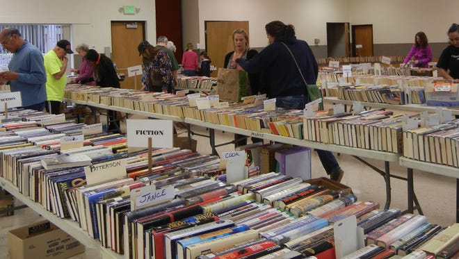 Shoppers browse through the books available at the Stayton Friends of the Library Used Book Sale.